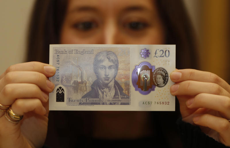 The new 20 pound bank note is displayed during a photo opportunity at the Tate Britain in London, Thursday, Feb. 20, 2020. The new 20 pound note featuring the artist JMW Turner enters circulation on Feb. 20. (AP Photo/Frank Augstein)