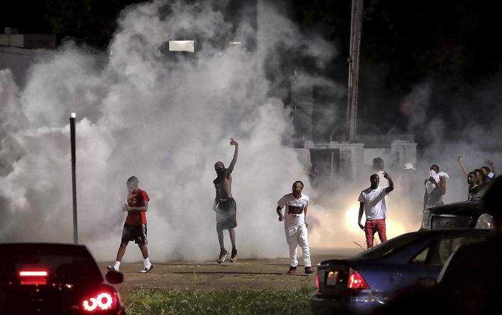 Frayser community residents taunt authorities as protesters take to the streets in anger against the shooting of a youth identified by family members as Brandon Webber by U.S. Marshals earlier in the evening, Wednesday, June 12, 2019, in Memphis, Tenn. Dozens of angry protesters clashed with police throwing stones and tree limbs until police forces broke the mob up with tear gas. (Photo: Jim Weber/Daily Memphian via AP)