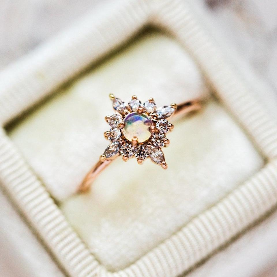 """<p>There's no doubt they'll feel like royalty with the round opal and marquise stones on the <a href=""""https://www.popsugar.com/buy/Skylar-Ring-Opal-531199?p_name=Skylar%20Ring%20With%20Opal&retailer=localeclectic.com&pid=531199&price=380&evar1=fab%3Aus&evar9=44555978&evar98=https%3A%2F%2Fwww.popsugar.com%2Fphoto-gallery%2F44555978%2Fimage%2F47011748%2FSkylar-Ring-With-Opal&list1=wedding%2Cjewelry%2Crose%20gold%2Cengagement%20rings&prop13=api&pdata=1"""" rel=""""nofollow noopener"""" class=""""link rapid-noclick-resp"""" target=""""_blank"""" data-ylk=""""slk:Skylar Ring With Opal"""">Skylar Ring With Opal</a> ($380).</p>"""