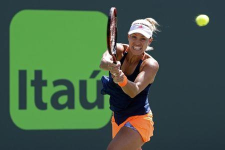 Mar 26, 2017; Miami, FL, USA; Angelique Kerber of Germany hits a backhand against Shelby Rogers of the United States (not pictured) on day six of the 2017 Miami Open at Crandon Park Tennis Center. Kerber won 6-4, 7-5. Mandatory Credit: Geoff Burke-USA TODAY Sports
