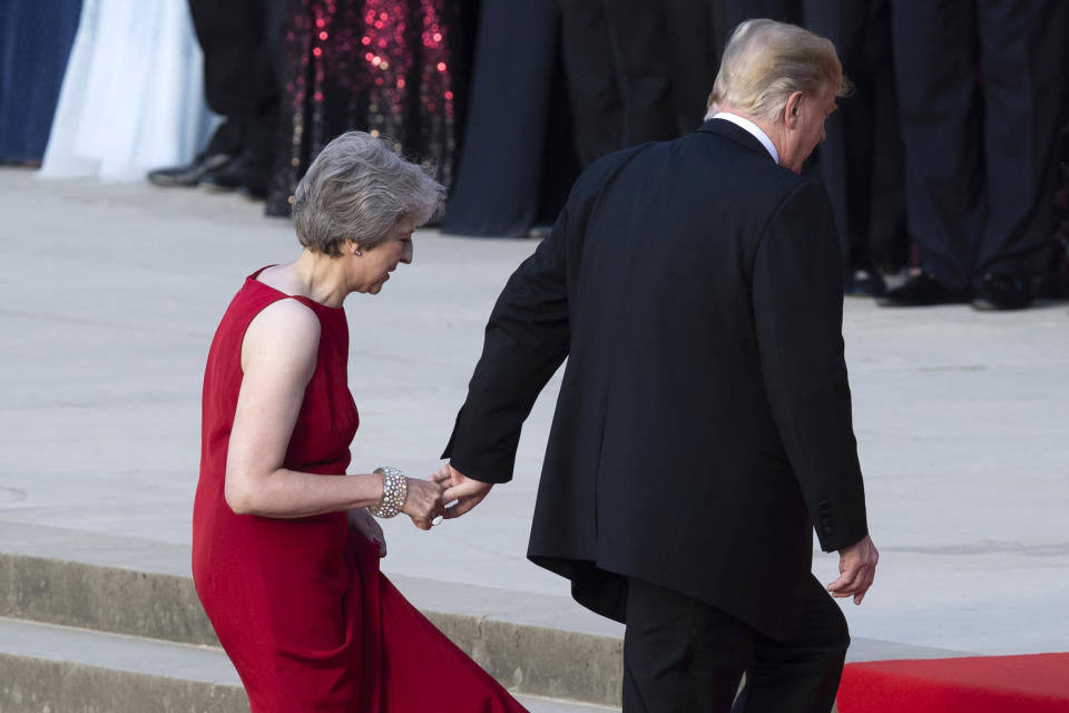 President Trump led British Prime Minister Theresa May up the stairs at Blenheim Palace in Woodstock, England. (Photo: Getty Images)