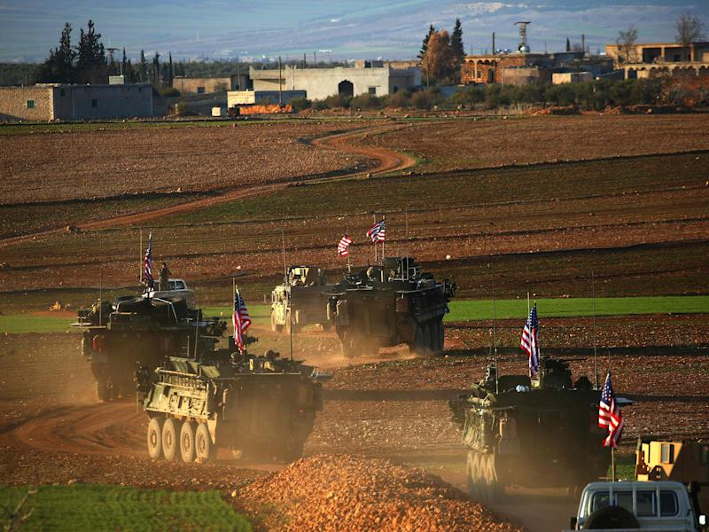 A convoy of US forces armoured vehicles drives near the village of Yalanli, on the western outskirts of the northern Syrian city of Manbij, on March 5, 2017: AFP/Getty