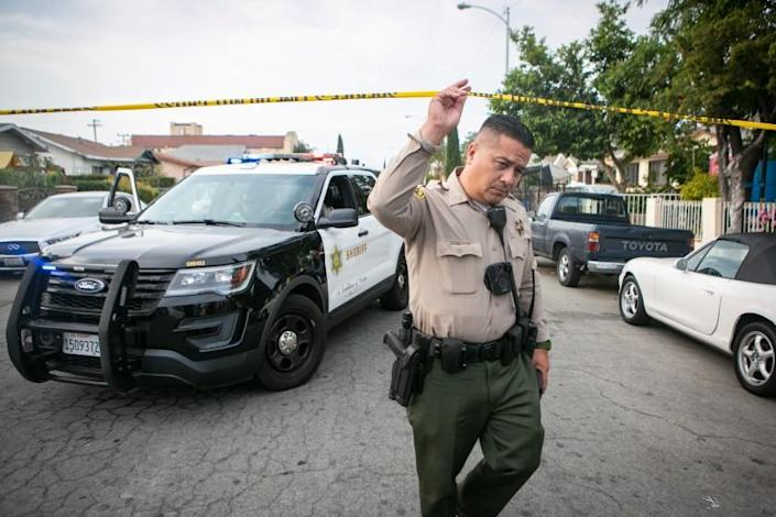 EAST LOS ANGELES, CA - JUNE 28: Police work the crime scene where three children were found dead at a home on South Ferris Ave in East Los Angeles on Monday, June 28, 2021 in East Los Angeles, CA. (Jason Armond / Los Angeles Times)