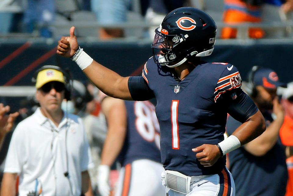 Bears quarterback Justin Fields gives a thumbs up to fans as he runs on the field before Chicago's game against the Bengals at Soldier Field on September 19.