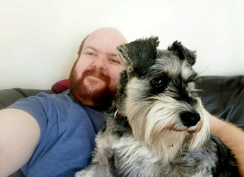 Clayton posed with his schnauzer in his advert. (SWNS)