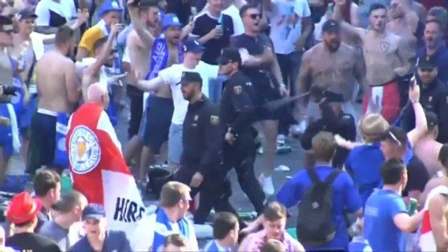 Riot police clash with Leicester City fans in Madrid
