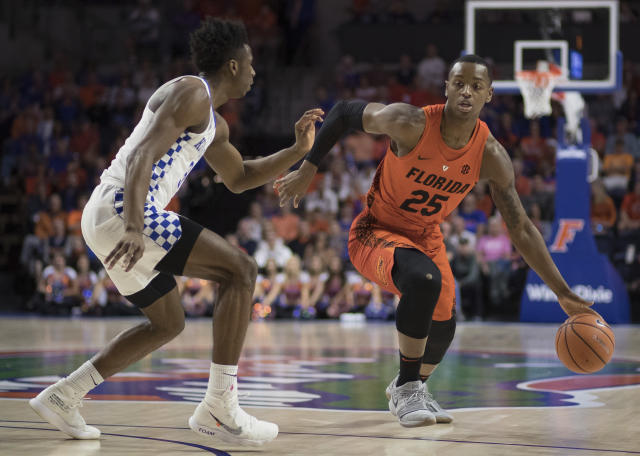 Florida forward Keith Stone (25) dribbles against the defense by Kentucky guard Hamidou Diallo (3) during the first half of an NCAA college basketball game in Gainesville, Fla., Saturday, March 3, 2018. (AP Photo/Ron Irby)