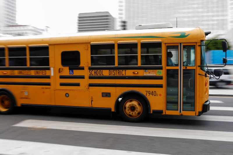 School bus drivers take part in caravan to demand proper funding for schools to support distant learning and a safe return to classes, in Los Angeles