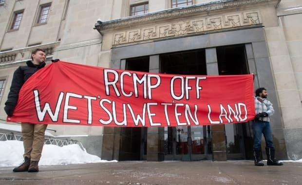 Protestors stand outside the Justice Canada building in Ottawa Feb. 11, 2020. The protesters were showing solidarity with Wet'suwet'en First Nation.
