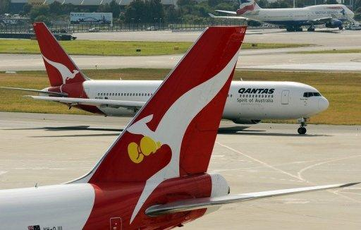 Two Qantas planes at Sydney International Airport