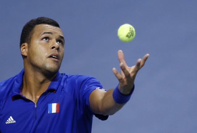 France's Jo-Wilfried Tsonga serves to Germany's Tobias Kamke during their Davis Cup quarter-final single tennis match in Nancy, eastern France, April 6, 2014. REUTERS/Vincent Kessler (FRANCE - Tags: SPORT TENNIS)