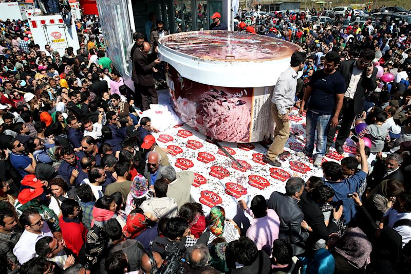 5-tons of ice-cream made by Iranian Choopan dairy is displayed during a ceremony at the Tochal mountainous area of northern Tehran, Iran, Monday, April 1, 2013. Choopan dairy unveiled 5-tons of chocolate ice-cream, the largest in the world, according to the factory officials. (AP Photo/Ebrahim Noroozi)