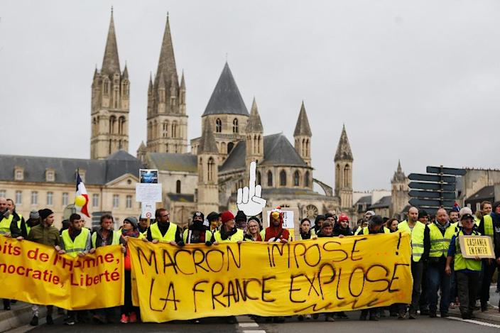 The yellow vest protests erupted in November over fuel tax increases seen as unfairly weighing on provincial voters who depend on their cars for transport (AFP Photo/CHARLY TRIBALLEAU)