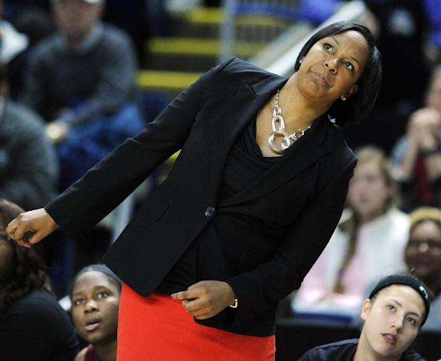 Temple head coach Tonya Cardoza watches action during the first half of an NCAA college basketball game against Connecticut in Bridgeport, Conn., Saturday, Jan. 11, 2014. (AP Photo/Fred Beckham)