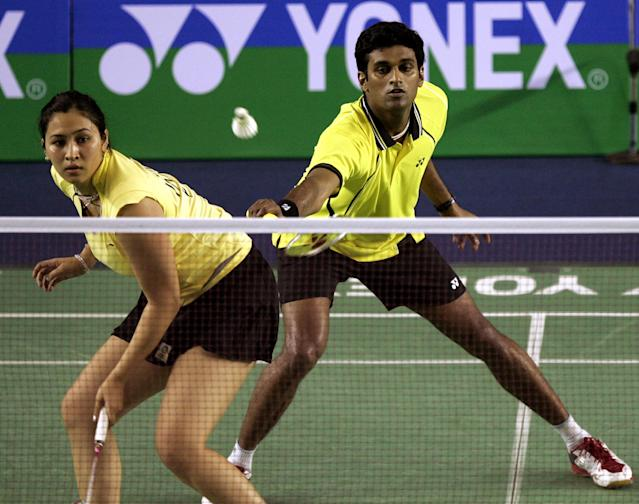 V. Diju of India, right, returns a shot against Joachim Fischer Nielsen and Christinna Perdersen of Denmark, as his teammate Jwala Gutta looks on during their final match against at the Badminton World Super Series Masters Finals in Johor Bahru, southern Malaysia, Sunday, Dec. 6, 2009. Denmark won 21-14, 21-18. (AP Photo/Lai Seng Sin)