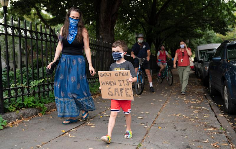Teachers, parents and children march in the Brooklyn borough of New York in September to protest the reopening of public schools amid the coronavirus pandemic and the threat of a teachers' strike.