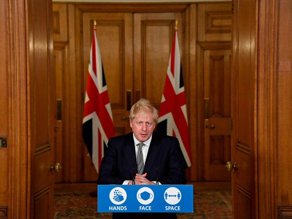 Boris Johnson speaks during a virtual press conference inside 10 Downing Street (POOL/AFP via Getty Images)
