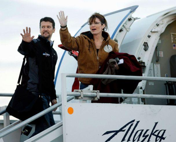 PHOTO: In this Nov. 4, 2008 file photo, Republican vice presidential candidate Alaska Gov. Sarah Palin and her husband Todd wave as they leave Anchorage International Airport in Anchorage bound for Wasilla to vote in the presidential election. (Ted S. Warren/AP, File)