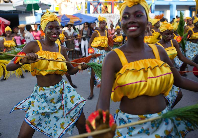 Dancers perform at a Carnival parade in Les Cayes, Haiti, Tuesday, Feb. 28, 2017. Haiti's three-day Carnival festivities have brought rum-fueled parties, imaginative costumes and high-energy dance music to a southern city that's still recovering from last year's punishing Hurricane Matthew. (AP Photo/Dieu Nalio Chery)