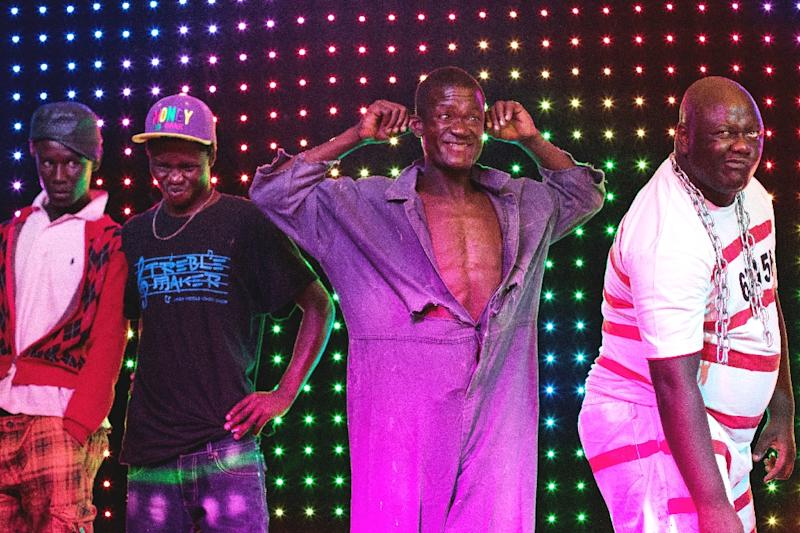 "Contenders in the ""Ugly man"" pageant pose for the judges panel during the ""Ugliest Man"" contest in Harare, Zimbabwe (AFP Photo/Jekezai Njikizana)"