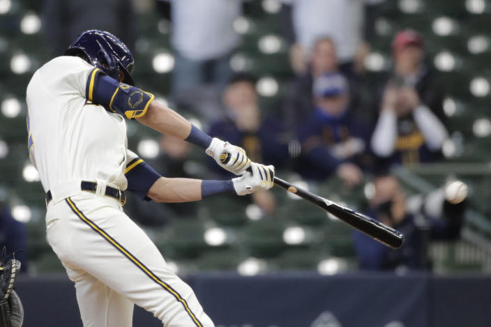 Milwaukee Brewers' Christian Yelich hits an RBI single during the ninth inning of the team's opening-day baseball game against the Minnesota Twins on Thursday, April 1, 2021, in Milwaukee. (AP Photo/Aaron Gash)