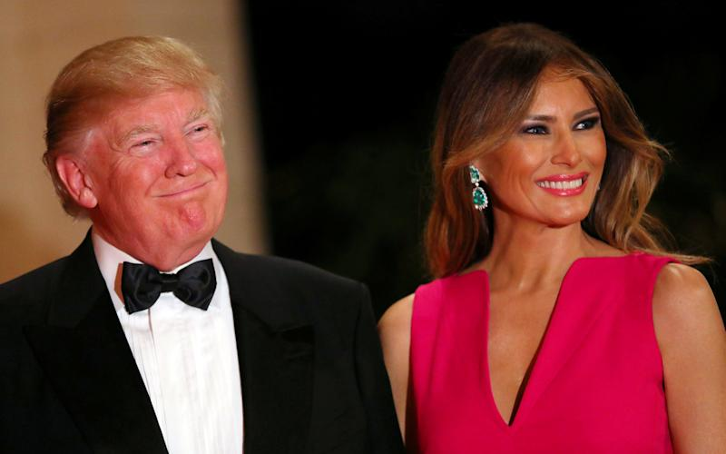 Donald Trump and First Lady Melania Trump attend the 60th Annual Red Cross Gala at Mar-a-Lago club in Palm Beach, Florida - Credit: CARLOS BARRIA/REUTERS