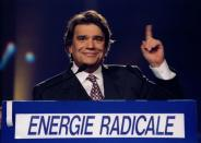 FILE PHOTO: French businesman and European election candidate Bernard Tapie delivers his speech at a campaign meeting