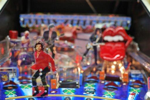A close-up shot of the Rolling Stones pinball machine in the midst of assembly at Stern Pinball in Chicago on August 15, 2011. The machine has a Mick Jagger figurine which dances back and forth across the playfield blocking the ball, while the signature red lips and tongue perches on top of one of the ramps