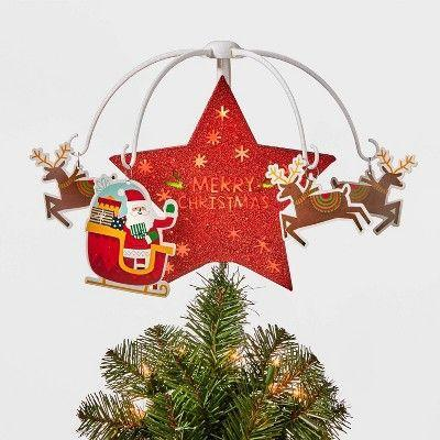 """<p><strong>Wondershop</strong></p><p>target.com</p><p><strong>$35.00</strong></p><p><a href=""""https://www.target.com/p/light-star-santa-38-reindeer-spinning-led-tree-topper-red-wondershop-8482/-/A-79468937"""" rel=""""nofollow noopener"""" target=""""_blank"""" data-ylk=""""slk:Shop Now"""" class=""""link rapid-noclick-resp"""">Shop Now</a></p><p>With an LED-lit star, Santa and reindeer, this decoration checks all the Christmas boxes and makes the perfect tree topper.</p>"""