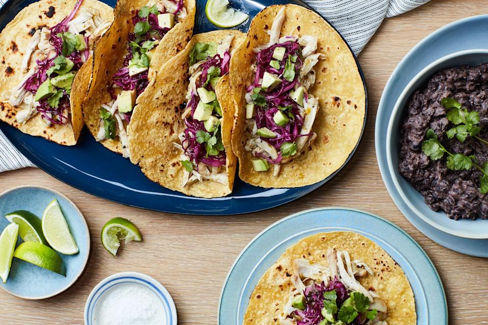 """<a href=""""https://www.epicurious.com/recipes/food/views/crispy-chicken-and-potatoes-with-cabbage-slaw?mbid=synd_yahoo_rss"""" rel=""""nofollow noopener"""" target=""""_blank"""" data-ylk=""""slk:Make the chicken ahead of time"""" class=""""link rapid-noclick-resp"""">Make the chicken ahead of time</a>, then warm it in tangy tomatillo salsa and top it with a bright cabbage slaw. Serve it with super-fast, garlicky beans to round out your meal. <a href=""""https://www.epicurious.com/recipes/food/views/nextover-chicken-tacos-with-quick-refried-beans?mbid=synd_yahoo_rss"""" rel=""""nofollow noopener"""" target=""""_blank"""" data-ylk=""""slk:See recipe."""" class=""""link rapid-noclick-resp"""">See recipe.</a>"""