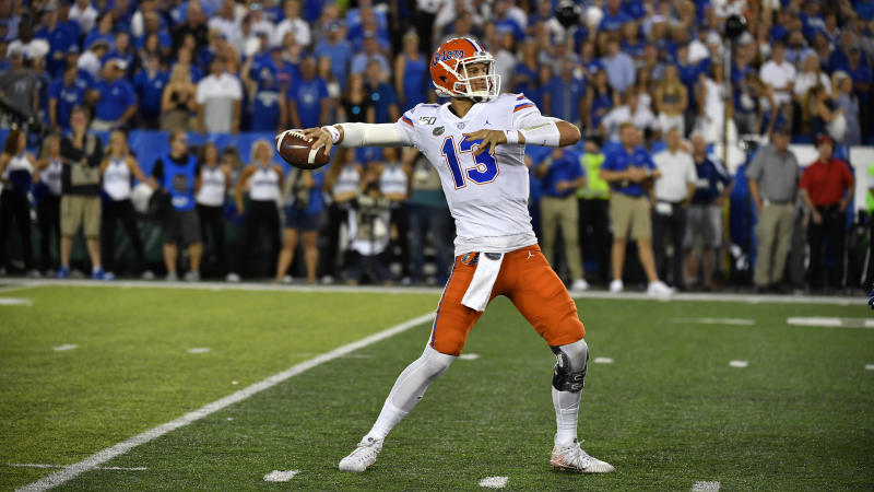 Florida quarterback Feleipe Franks (13) in action during the first half of an NCAA college football game in Lexington, Ky., Saturday, Sept. 14, 2019. (AP Photo/Timothy D. Easley)