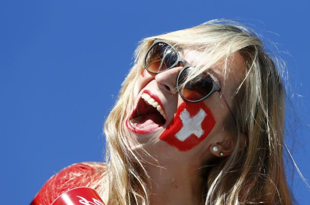 A Switzerland fan cheers before the 2014 World Cup round of 16 game between Argentina and Switzerland at the Corinthians arena in Sao Paulo July 1, 2014. REUTERS/Eddie Keogh (BRAZIL - Tags: SOCCER SPORT WORLD CUP)