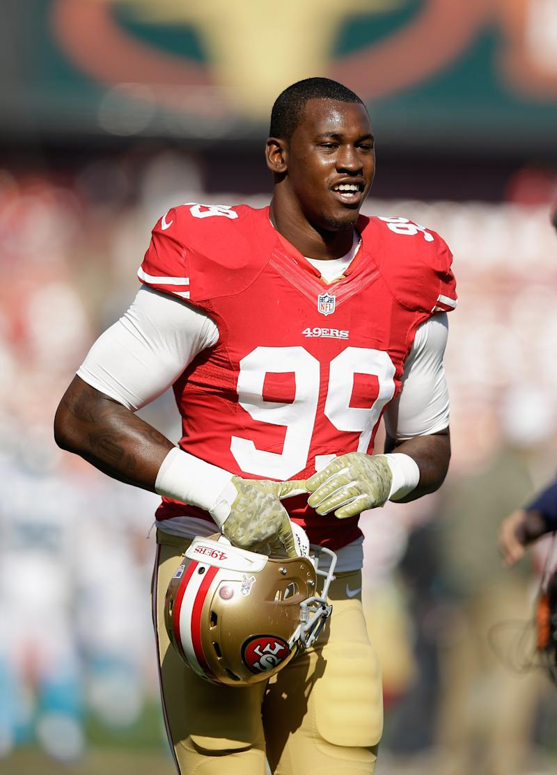 Aldon Smith of the San Francisco 49ers warms up before a game at Candlestick Park on November 10, 2013