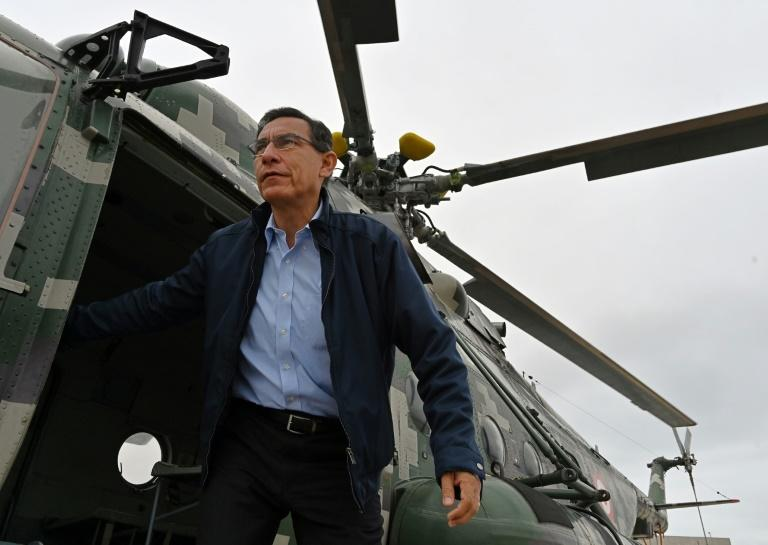 Peruvian President Martin Vizcarra is forecast to strengthen his position in the snap parliamentary election (AFP Photo/Cris BOURONCLE)