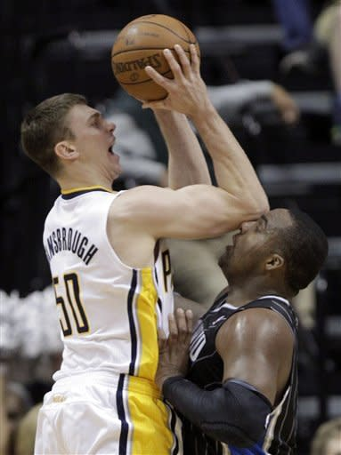 Indiana Pacers forward Tyler Hansbrough, left, hits Orlando Magic forward Glen Davis with his elbow as he shoots in the first half of Game 5 of an NBA basketball first-round playoff series, in Indianapolis on Tuesday, May 8, 2012. (AP Photo/Michael Conroy)