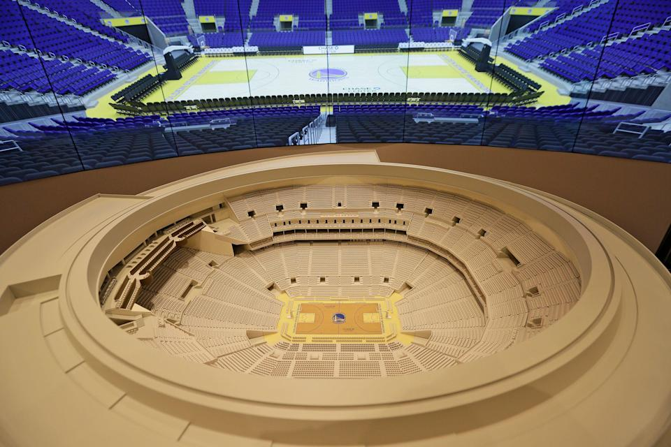 In this photo taken January 24, 2018, a model of the Chase Center is seen on display at the Chase Center Experience in San Francisco. The new home arena of the Golden State Warriors NBA basketball team opens in 2019. (AP Photo/Eric Risberg)