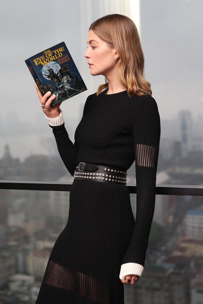 Actress Rosamund Pike reading the first book of Wheel of Time.