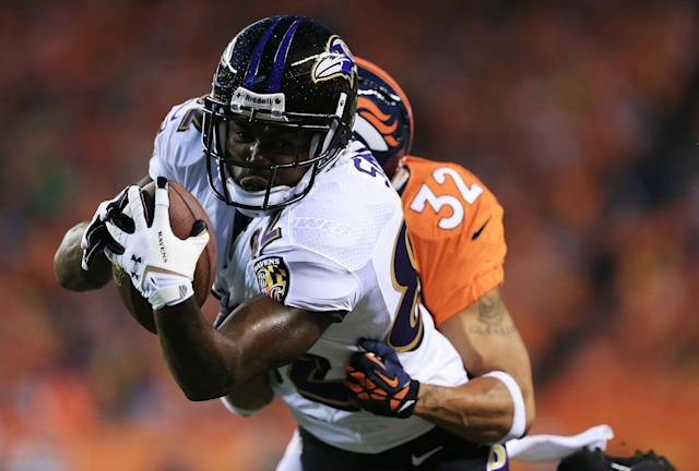DENVER, CO - SEPTEMBER 5: Torrey Smith #82 of the Baltimore Ravens runs with the ball after catching a pass in front of Tony Carter #32 of the Denver Broncos during the game at Sports Authority Field at Mile High on September 5, 2013 in Denver Colorado. (Photo by Doug Pensinger/Getty Images)