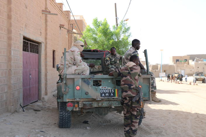 Malian forces patrol the streets of Timbuktu, Mali, Sunday Sept. 26, 2021. Many residents of Timbuktu are worried that when French troops pull out of the city in northern Mali, jihadis will return to impose strict Shariah law including public whippings and amputations. The Islamic extremists ruled Timbuktu in 2012 and banned music, sports and destroyed historic mausoleums, saying they were idolatrous. (AP Photo/Moulaye Sayah)