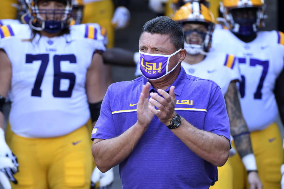 LSU head coach Ed Orgeron heads to the field with his team before the start an NCAA college football game against Missouri Saturday, Oct. 10, 2020, in Columbia, Mo. (AP Photo/L.G. Patterson)