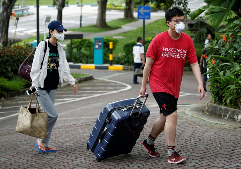 Students returning from China check in to a dormitory designated as a quarantine zone within Nanyang Technological University in Singapore