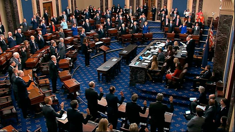 Supreme Court Chief Justice John Roberts swears in senators for the impeachment trial of President Donald Trump on Jan. 16, 2020, in the Capitol in Washington.