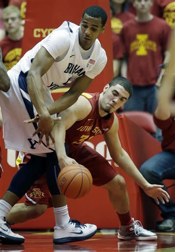 Brigham Young forward Brandon Davies, left, fights for the loose ball with Iowa State forward Georges Niang during the first half of an NCAA college basketball game, Saturday, Dec. 1, 2012, in Ames, Iowa. (AP Photo/Charlie Neibergall)