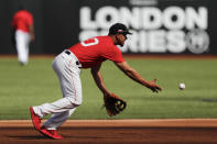 Boston Red Sox third baseman Marco Hernandez fields a ball during batting practice in London, Friday, June 28, 2019. Major League Baseball will make its European debut with the New York Yankees versus Boston Red Sox game at London Stadium this weekend. (AP Photo/Frank Augstein)