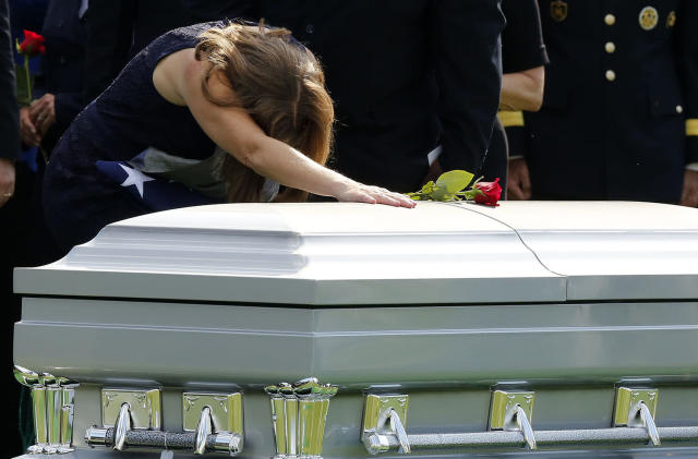 <p>Susan Myers, wife of U.S. Army Maj. Gen. Harold J. Greene, pats his casket during the end of a full military honors funeral at Arlington National Cemetery in Virginia, Aug. 14, 2014. Greene was killed in Afghanistan earlier this month and is the highest ranking U.S. military officer killed in combat since the Vietnam War. (Photo: Larry Downing/Reuters) </p>