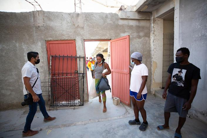 Haitian migrants arrive at a newly designated space as authorities determine their migratory status so they can remain in Ciudad Acuña.