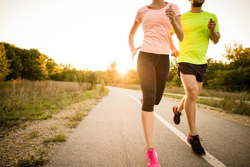 a man and a woman jogging together