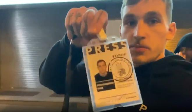 Two of the group wore press passes, saying they would be writing for Ukrainian media when they returned home. Photo: Handout