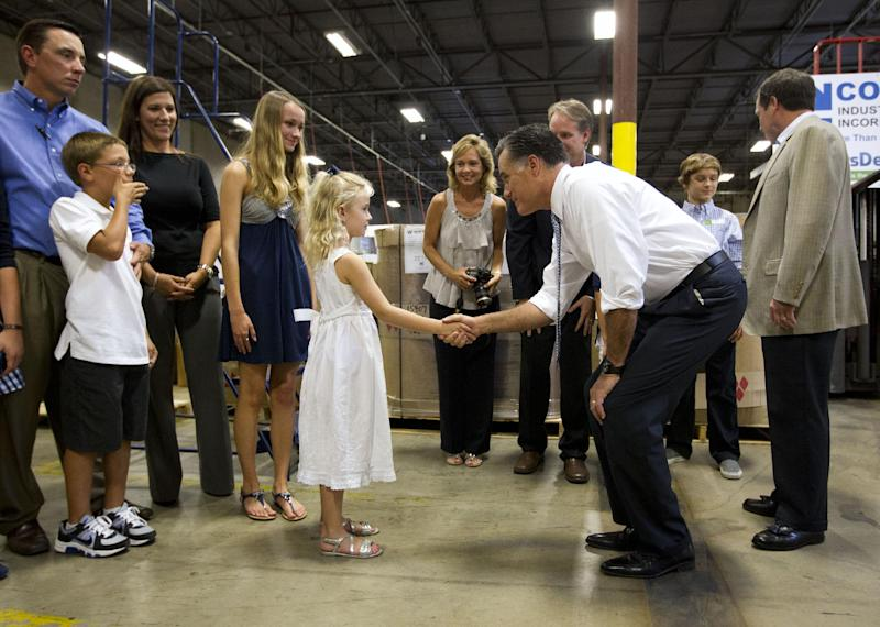 Republican presidential candidate, former Massachusetts Gov. Mitt Romney shakes hands backstage during a campaign stop at Con-Air Industries, Tuesday, June 12, 2012, in Orlando, Fla. (AP Photo/Evan Vucci)
