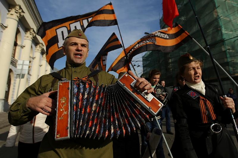 A man wearing a Soviet army military uniform plays an accordion as he takes part in a rally and a concert in central Moscow on March 18, 2015, to mark one year since Russia's President Vladimir Putin signed off on the annexation of Crimea (AFP Photo/Kirill Zykov)